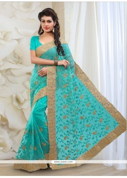 Innovative Turquoise Embroidered Work Net Classic Designer Saree
