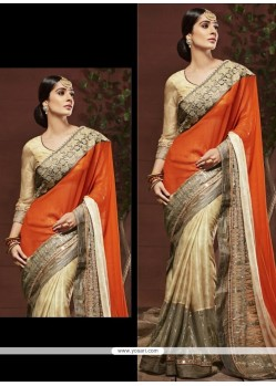 Beauteous Beige And Orange Georgette Designer Saree