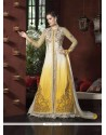Desirable Georgette Cream And Yellow A Line Lehenga Choli