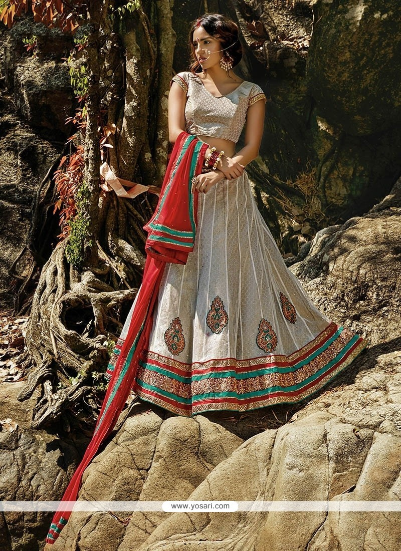 Winsome Off White Embroidered Work Net A Line Lehenga Choli