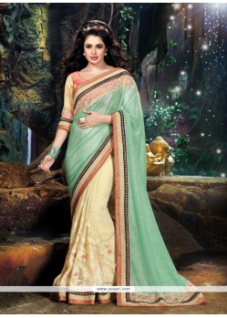 Fabulous Cream And Sea Green Patch Border Work Classic Designer Saree