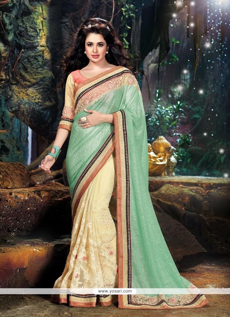 Fabulous Cream And Sea Green Patch Border Work Classic Designer Saree