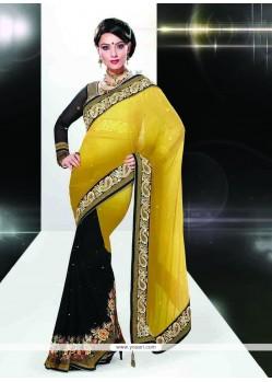 Modish Art Silk Black And Yellow Patch Border Work Classic Designer Saree