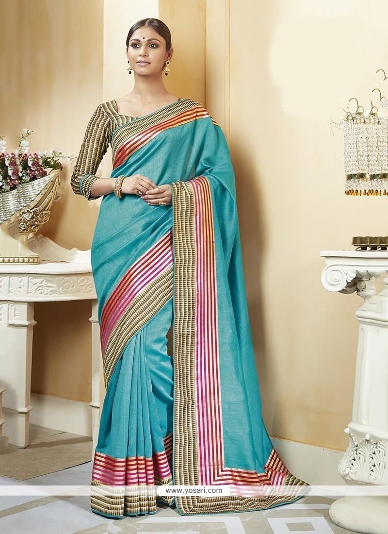 Mesmerizing Turquoise Patch Border Work Silk Printed Saree