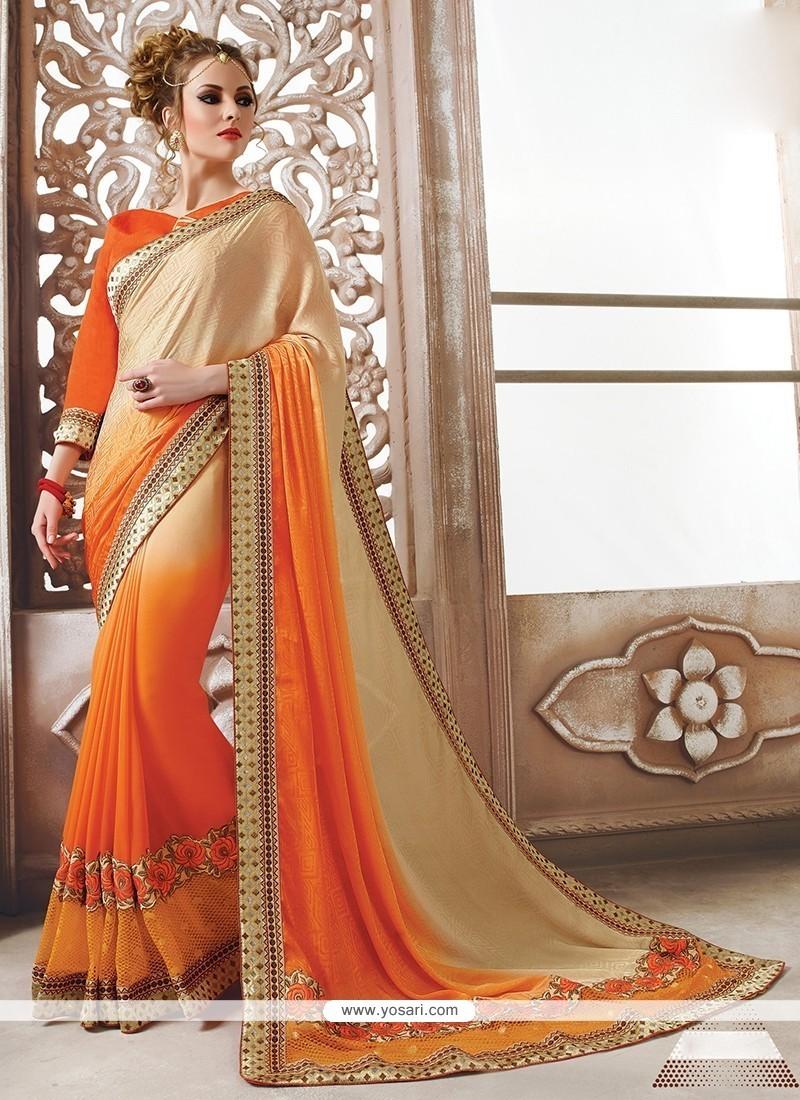 Thrilling Georgette Orange Designer Saree