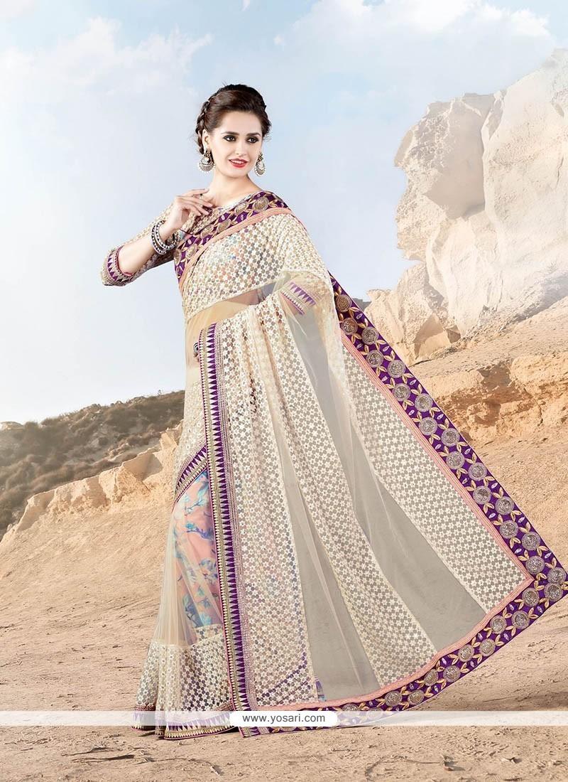 Captivating Patch Border Work Net Designer Saree