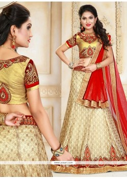 Capricious Gold And Red Patch Border Work Net A Line Lehenga Choli