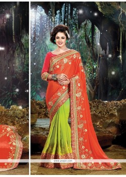 Exuberant Green And Orange Designer Traditional Sarees