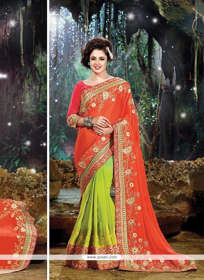 Exuberant Green And Orange Designer Traditional Sarees