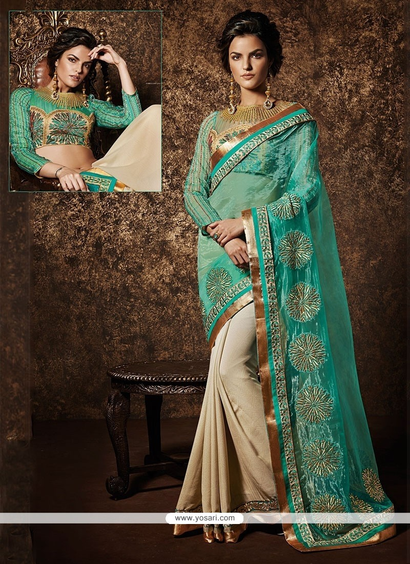 Cream And Turquoise Net Designer Saree