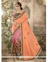Enticing Georgette Orange And Pink Designer Saree