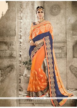 Simplistic Blue And Orange Georgette Designer Saree
