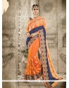 Simplistic Blue And Orange Georgette Designer Saree