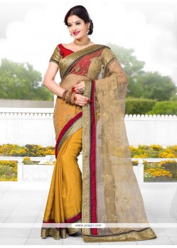 Cream And Mustard Net Designer Saree