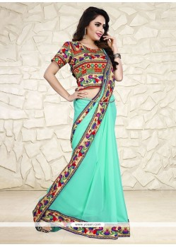 Majestic Turquoise Georgette Printed Saree