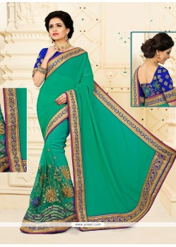 Blissful Sea Green Embroidered Work Net Designer Half N Half Saree