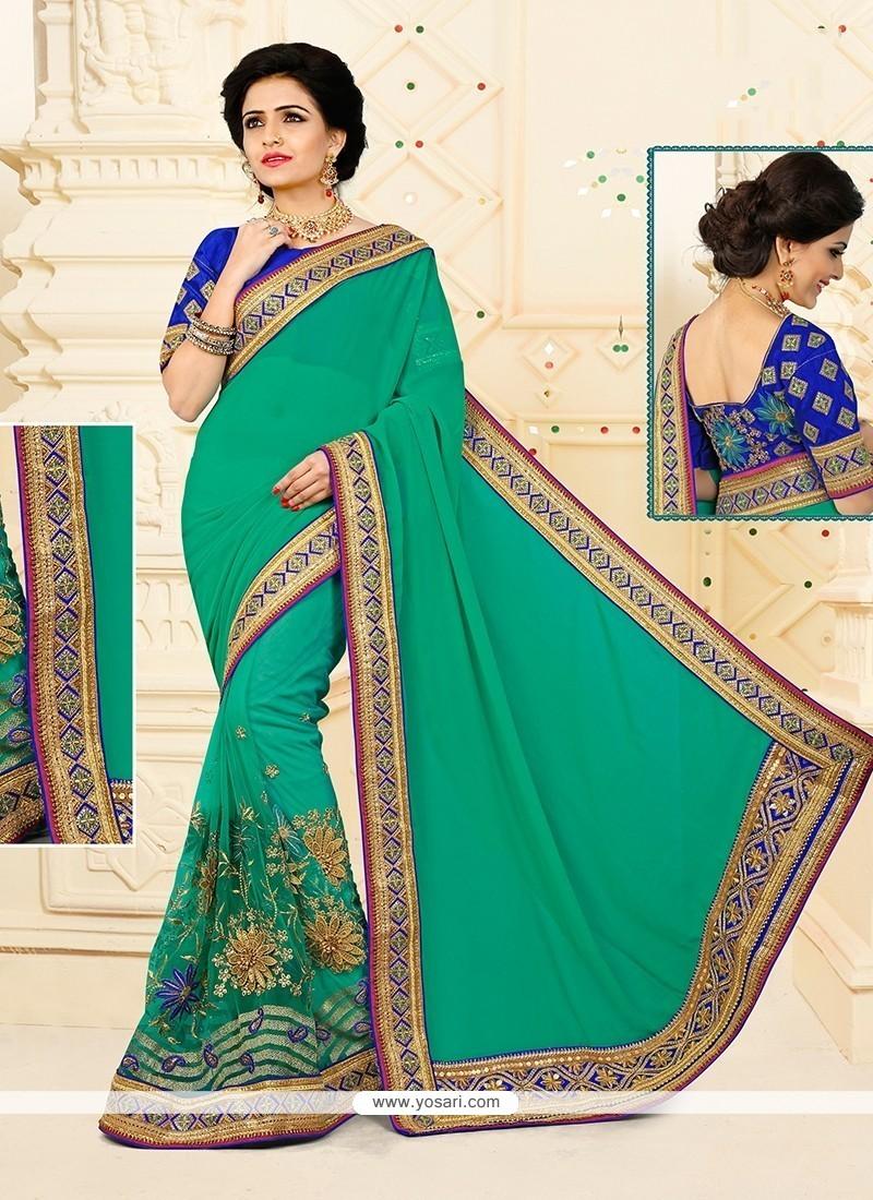 Blissful Sea Green Embroidered Work Net Designer Half N Half Saree