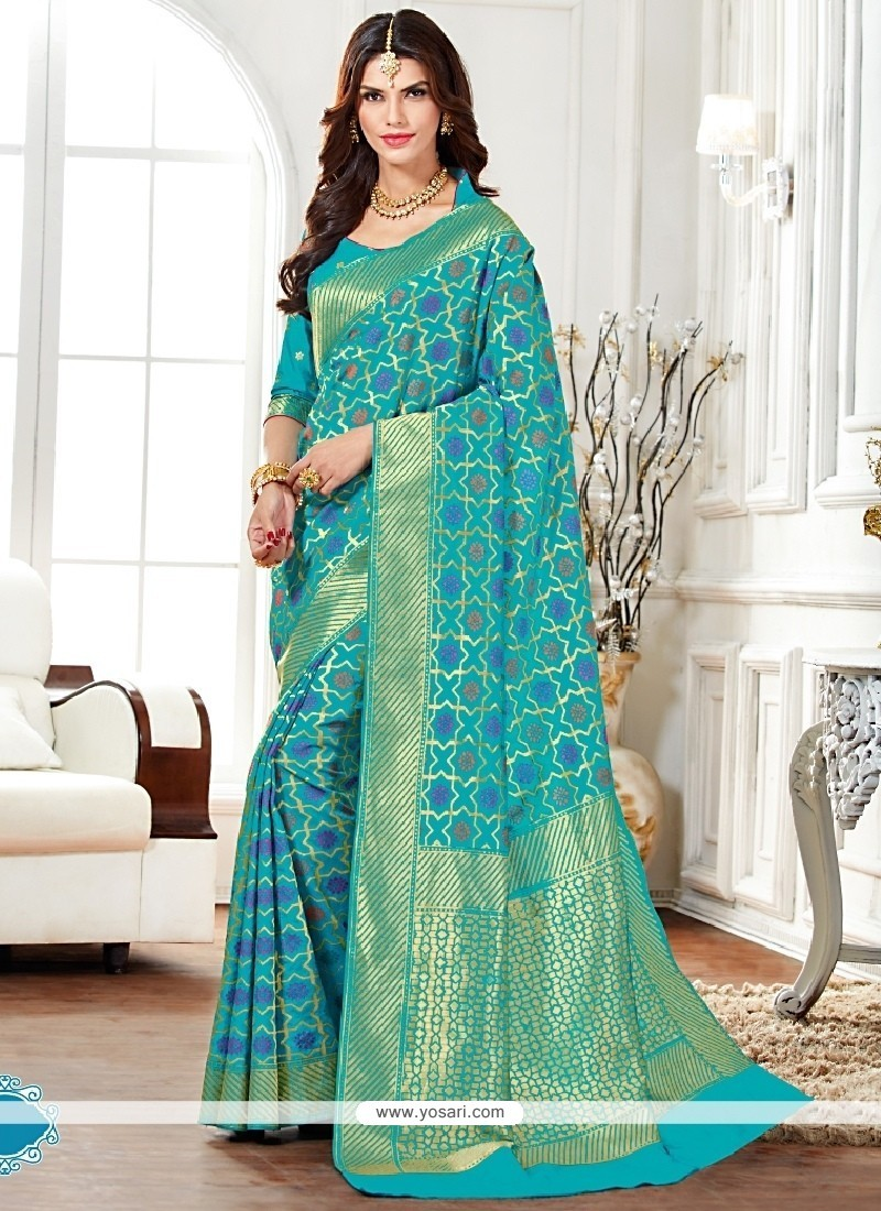 Resplendent Raw Silk Turquoise Patch Border Work Designer Saree