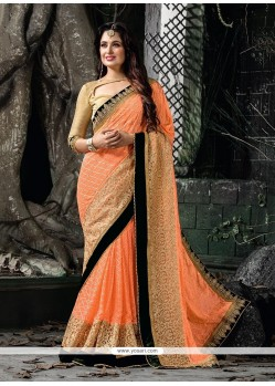 Scintillating Georgette Peach Classic Saree
