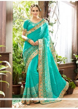 Fetching Patch Border Work Turquoise Georgette Traditional Saree