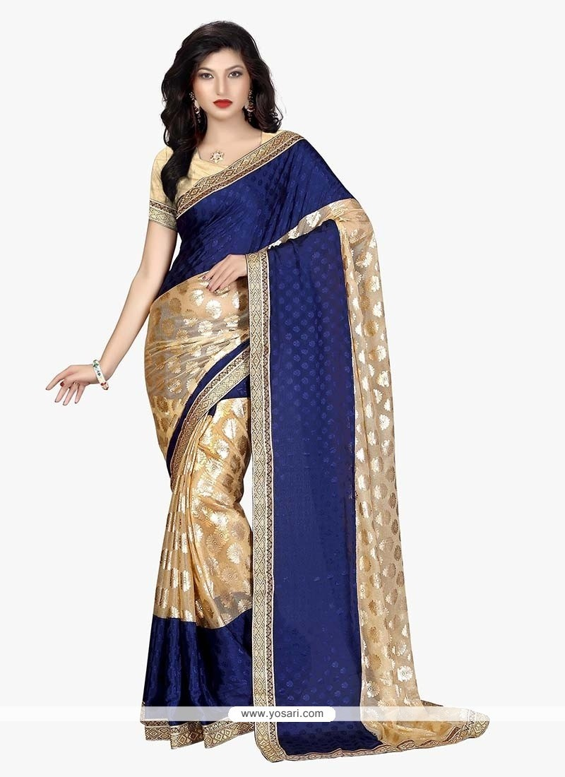 Gratifying Beige And Blue Faux Crepe Traditional Saree