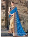 Glossy Beige And Blue Embroidered Work Raw Silk Traditional Saree