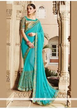 Gratifying Turquoise Georgette Designer Saree