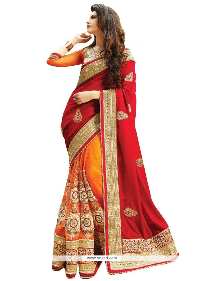 Irresistible Net Orange And Red Patch Border Work Designer Half N Half Saree