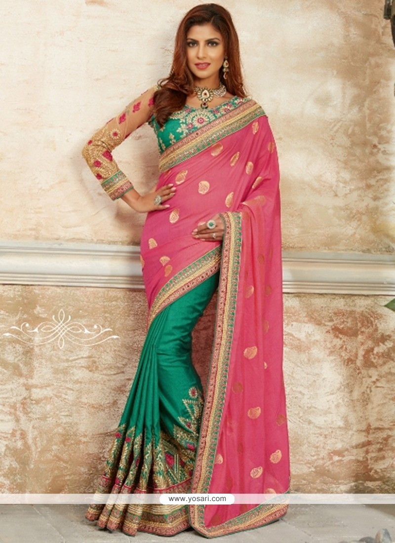 Voluptuous Pink And Sea Green Georgette Classic Designer Saree