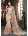Savory Beige And Peach Georgette Traditional Saree
