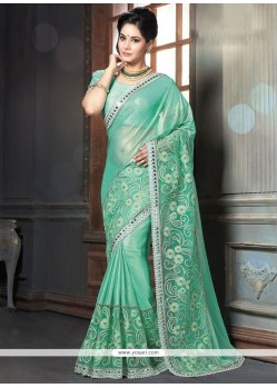 Bedazzling Georgette Sea Green Classic Designer Saree