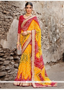 Energetic Yellow Patch Border Work Georgette Printed Saree