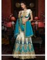 Exciting Fancy Fabric Cream And Turquoise Patch Border Work A Line Lehenga Choli