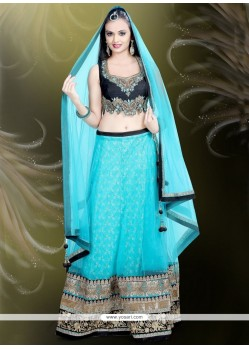 Impeccable Raw Silk Turquoise Patch Border Work A Line Lehenga Choli