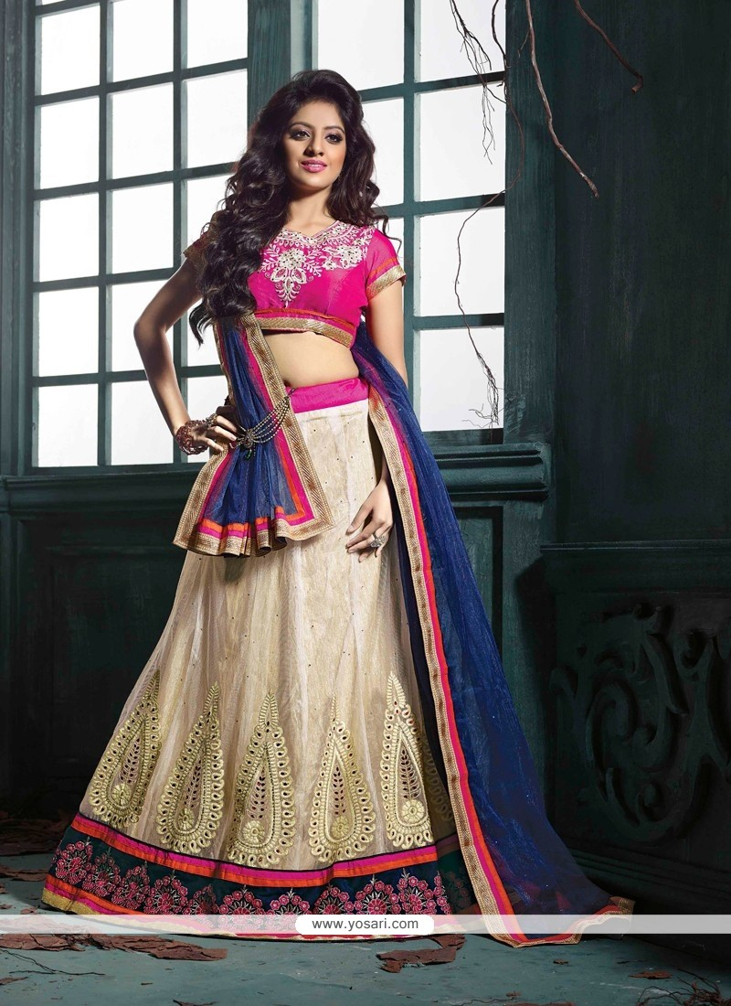 Deepika Singh Cream And Pink Net Lehenga Choli