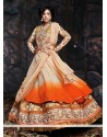 Cream And Orange Shaded Net Lehenga Choli