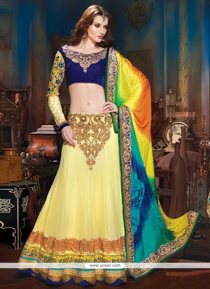 Yellow And Blue Soft Net Lahenga Choli
