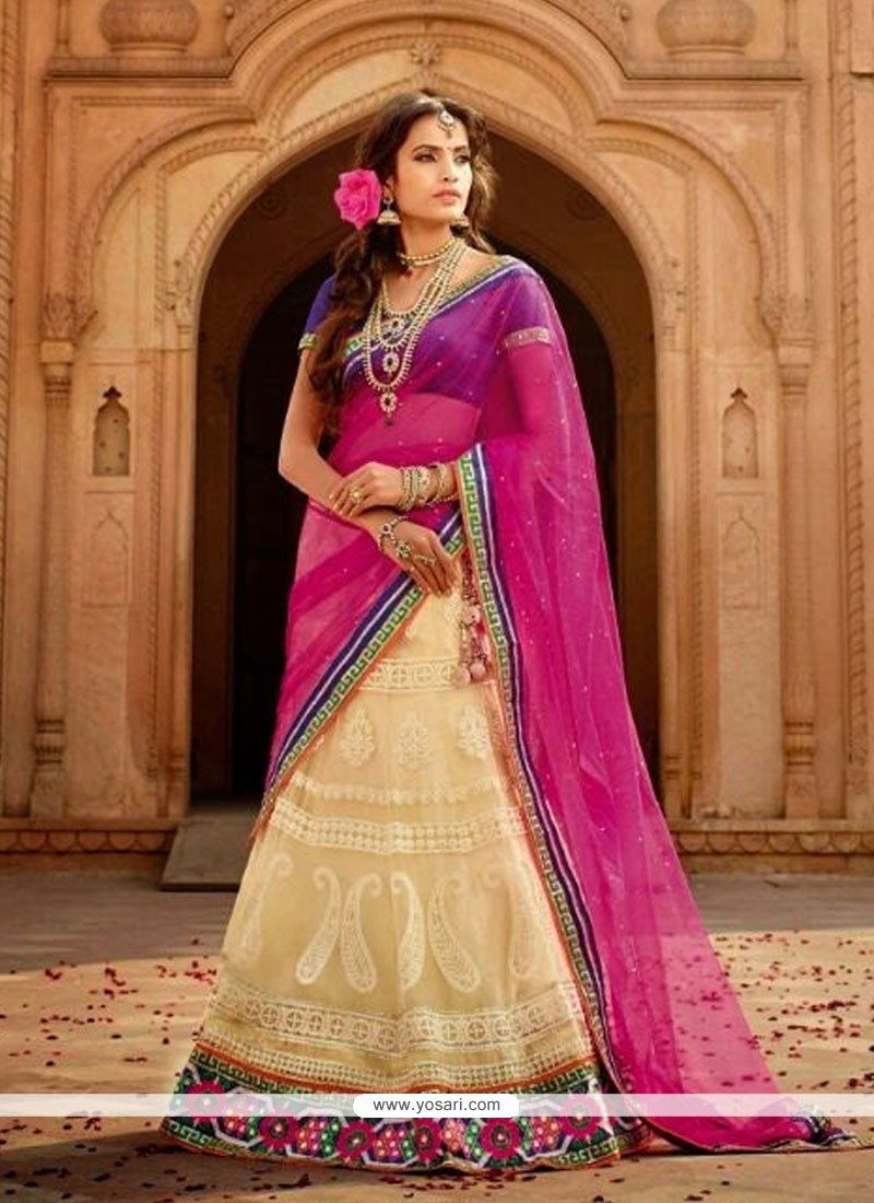 Fabulose Cream Embroidery Net Lehenga Choli
