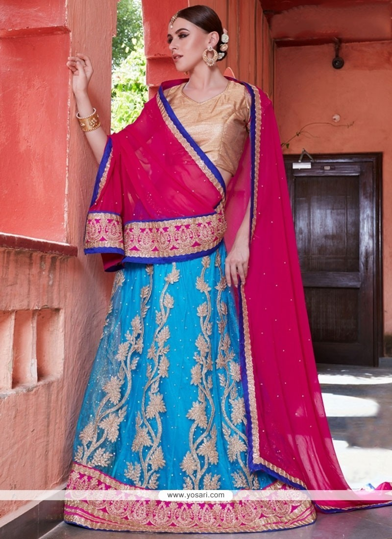 Superb Hot Pink And Turquoise Net Lehenga Choli