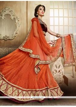 Fabulose Orange Net Lehenga Choli