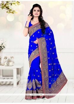 Intrinsic Faux Georgette Blue Zari Work Classic Designer Saree