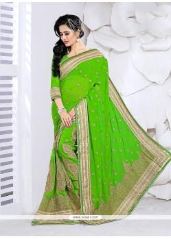 Fashionable Patch Border Work Faux Georgette Classic Designer Saree