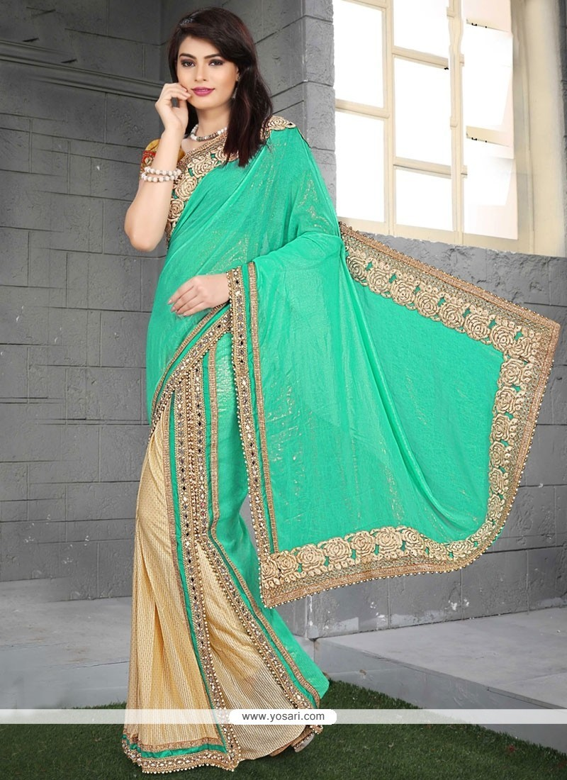 Scintillating Embroidered Work Beige And Sea Green Faux Georgette Classic Saree