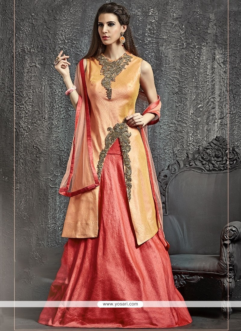 Ravishing Raw Silk Orange And Pink Cutdana Work Lehenga Choli