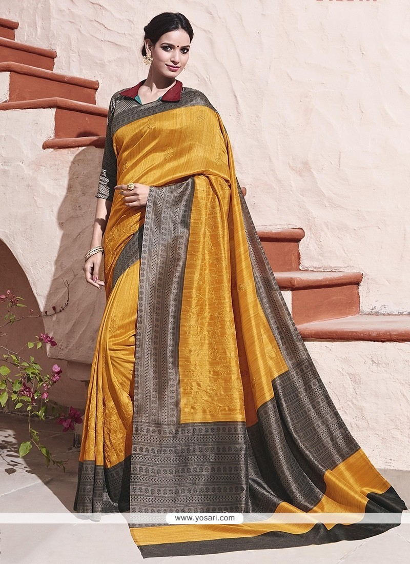 Impeccable Grey And Mustard Traditional Saree