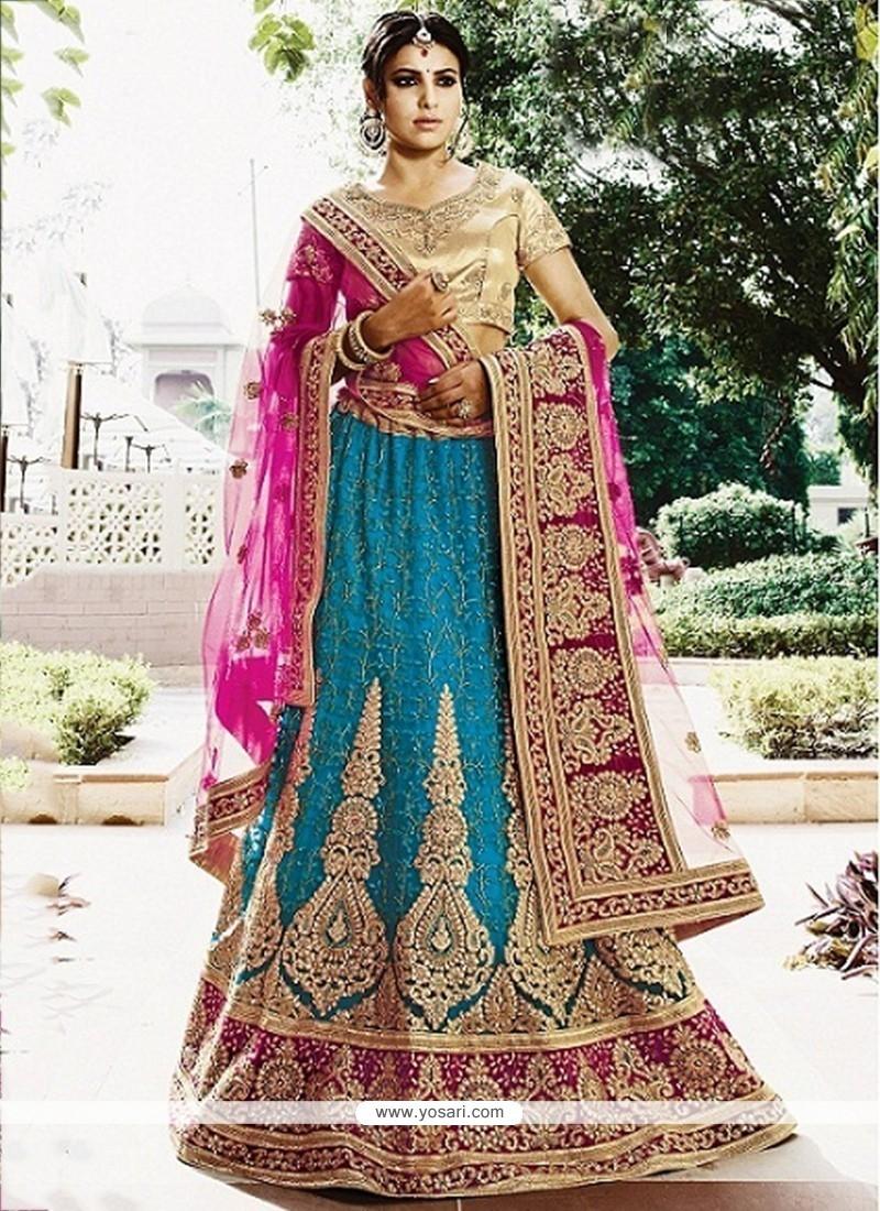 Exquisite Net Zari Work Lehenga Choli