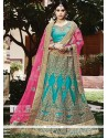 Sensible Net Sea Green Lehenga Choli