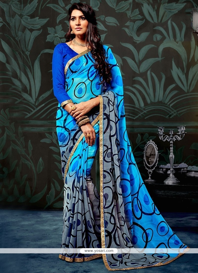 Titillating Blue And Grey Lace Work Printed Saree