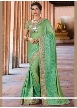Mesmeric Sea Green Patch Border Work Traditional Saree