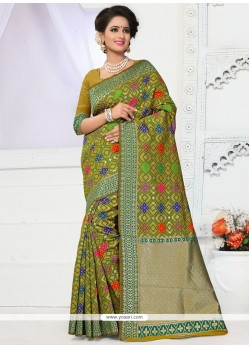 Thrilling Green Weaving Work Traditional Designer Saree